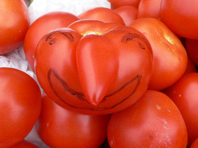 The tomato man always draws faces on his unusually-shaped tomatoes. I love that little detail.