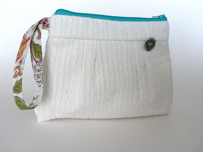Eco Wristlet made from recycled linens and sweater.