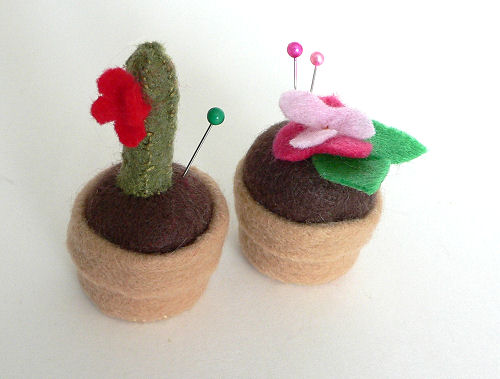 Pincushions made from bottle caps and felt scraps.